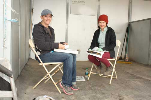 Farrier Meredith Clark and assistant farrier Shauna Malhoun.