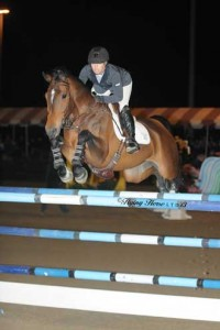 Ashlee Bond pilots the bay mare Wistful over a veritcal jump.