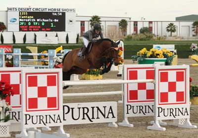 Meredith Michaels-Beerbaum and Cantano clear the checkerboard Purina jump.